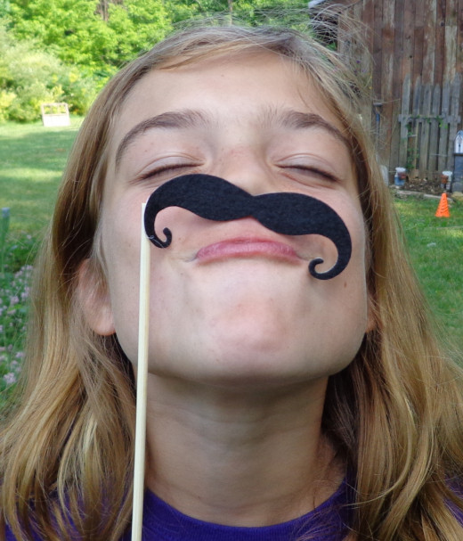 the mustache comes off the card to wear and act silly with