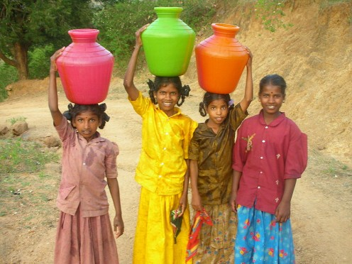 Girls carrying water in India