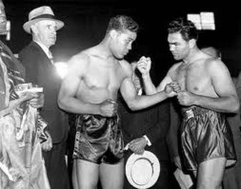 Joe Louis, left, destroyed Max Schmeling in one brutal round. The knockout avenged the Brown Bombers earlier career defeat to Schmeling.
