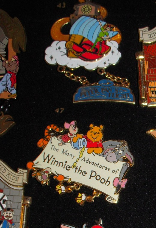 Attraction pins with dangles, small features that drop from the pin and hang.