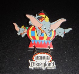 Unusual Dumbo pin features both moving Dumbos (sides) and a dangle.