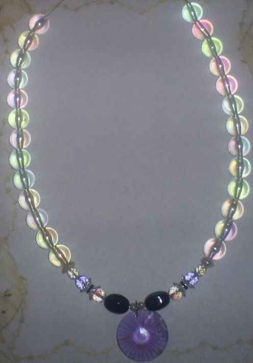 This is what the necklace looks like when almost all the acrylic beads have been added.