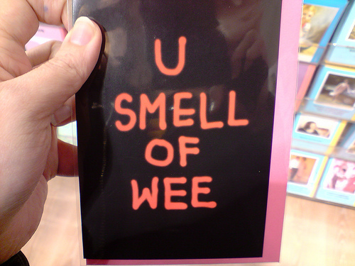 "A humorous gift card that says, ""u smell of wee"""