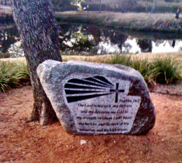 A rock with scripture in a church park area!