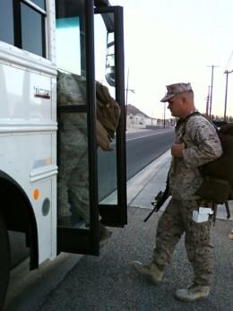 In the bus doorway.
