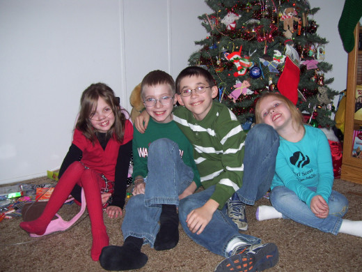 Rayni, Christopher, Dakota & Cassie.  Rayni delivered Rayni Day Miracles Christmas Presents to Christopher one year because he was too sick to travel.
