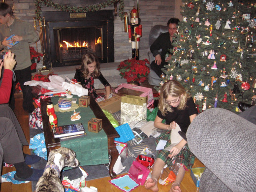 Grandchildren hard at work opening presents