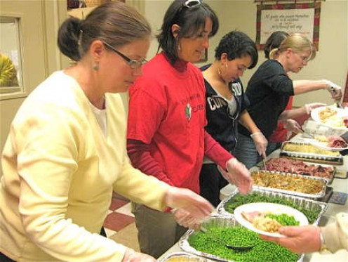 Volunteer to help feed the hungry at a food kitchen