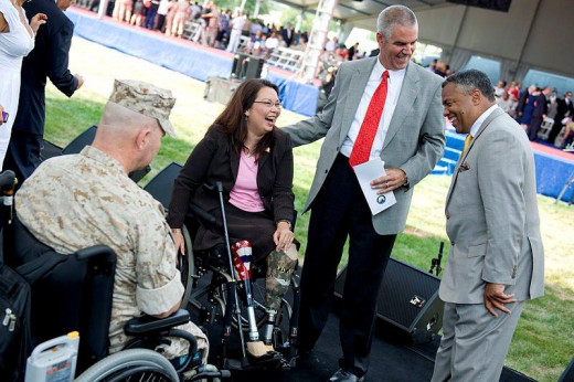 Tammy Duckworth , wounded warrior, laughs with U.S. Rep. Sanford D. Bishop Jr. of Georgia, at Bethesda National Naval Medical Center, Md., June 24, 2010.   DOD photo by Cherie Cullen