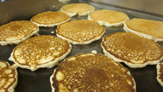 Hot pancakes are ready to be taken off the grill.