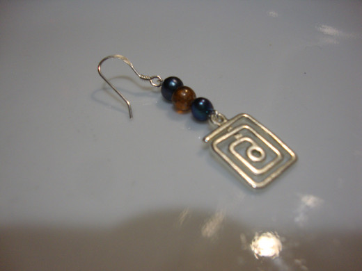 Wire with small beads atop cool charm.