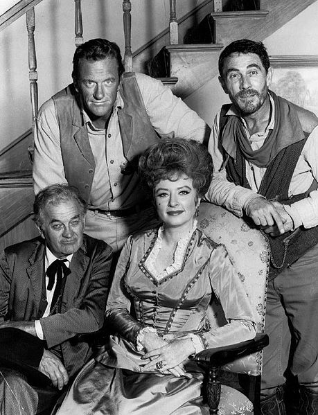 In this photo you can see the main cast of the TV Show Gunsmoke. Clockwise from top: James Arness (Matt), Ken Curtis (Festus), Amanda Blake (Kitty), and Milburn Stone (Doc) in 1968. Chester is not in the photo but he was the earlier deputy.