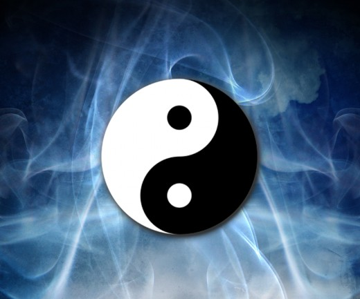 "Yin and Yang, a classic Taoist symbol literally meaning ""shadow and light"" .  Yin is the black side with the white Yang dot on it and Yang is the white side with the black Yin dot on it."
