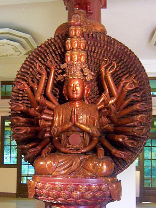 This idol shows  Avalokitesvara with Eleven Faces.The nine faces in a group of three are peaceful in appearance.The tenth head has ruthless looks.The eleventh which is on the top represents Amitabha Buddha.