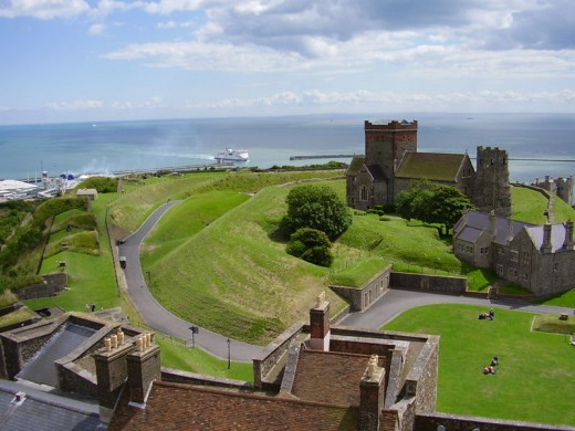 Church of St Mary in Castro in the grounds of Dover Castle, Kent, south coast of England, overlooking the English Channel. The church was built next to the remains of a Roman lighthouse, here seen to the right of the church, which was used as the chu