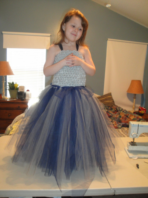 My daughter this year.  She saw a tutu-dress and that's all she wanted.  So my mother crocheted the top, and I looped on the rest.  A few handsewn stitches hold the straps in place, other then that, no-sewing involved!