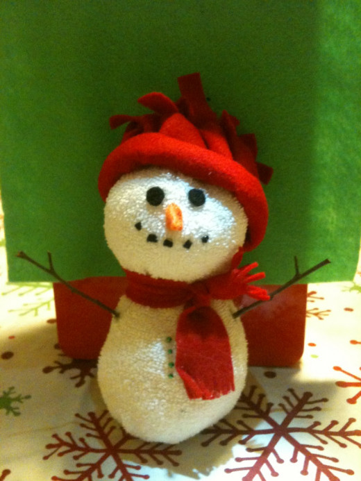 Holiday sock snowman decorations are inexpensive and fun to make.
