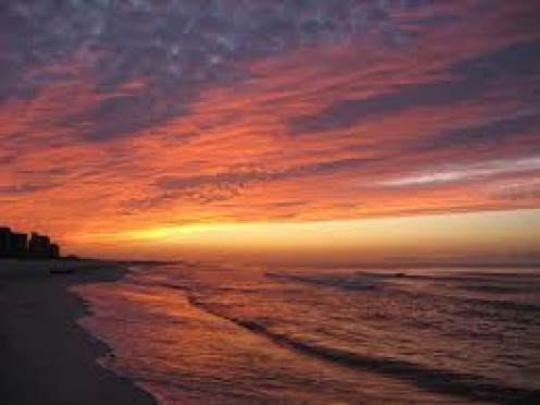 The sunset is a thing of beauty in Orange Beach, Alabama. Whether your laying in the sun or walking in the sunset, it's breathtaking.