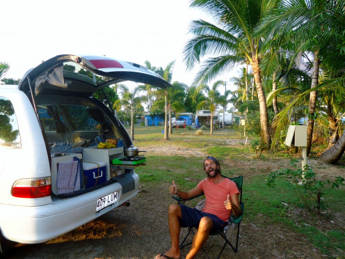 Relaxing by the Jucy Campers campervan
