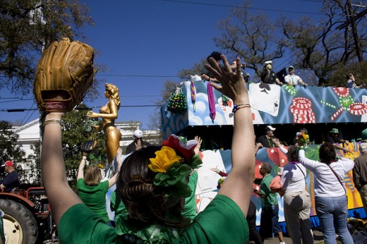 In this March 13, 2010 photograph of the Saint Patrick's Day Parade in New Orleans, Louisiana taken by Derek Bridges, a spectator uses a catcher's mitt for catching cabbages thrown from a parade float.