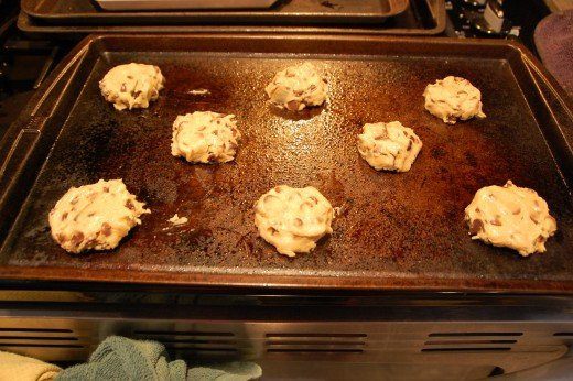 gently form and slightly flatten the 2 Tbsp cookie balls