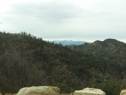 The view of Mount Baldy with boulders in the foreground.