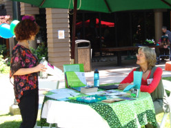 Staffing a table at a local event is a great way to donate your services. Not only can you share information about the nonprofit, but also can sell products and generate donations.