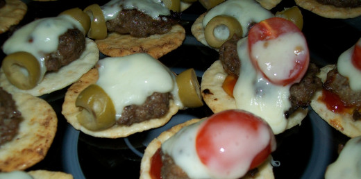 Gluten free mini cheeseburgers hot out of the oven.