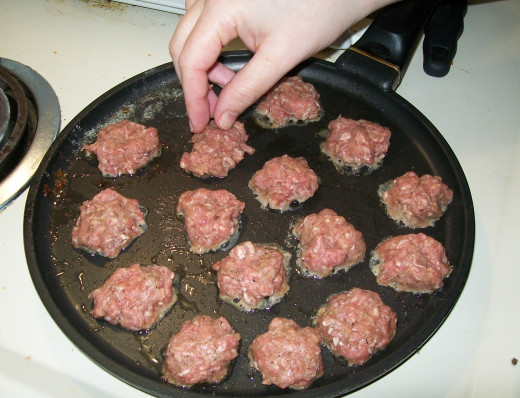 Cooking up the coin-sized burgers.