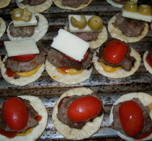 Customizing the mini burgers.