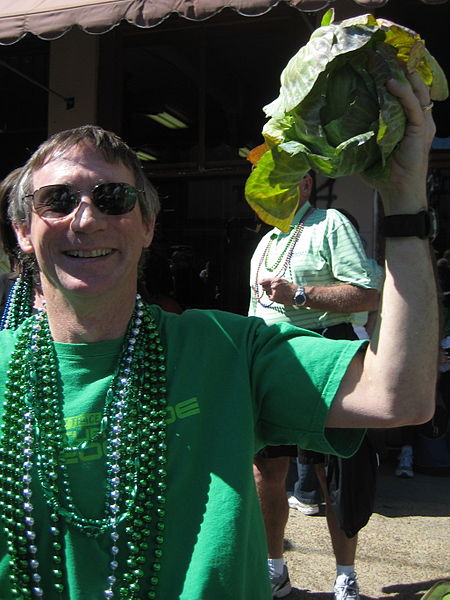 Allen Gathman photographed a parade goer holding up a cabbage thrown from a St. Patrick's Day Parade float in New Orleans, Louisiana on March 13, 2010.