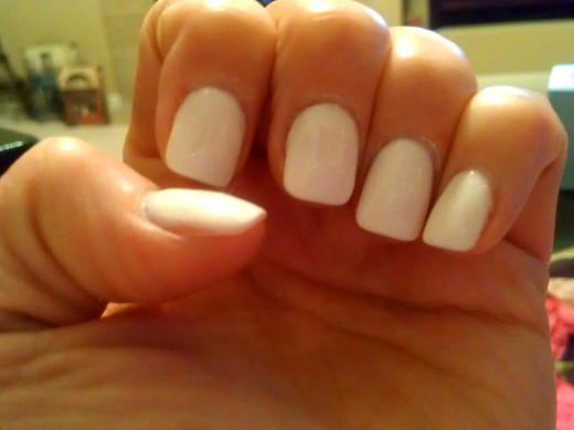 Paint your nails a light color that black will show up on