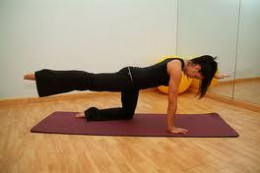 Balancing on an opposing leg and arm, raise the other leg and arm. Alternate sides and do it 15 times. Builds the core and trains balance.