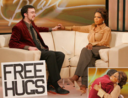 (This link is good) Juan Mann on Oprah TV Show/ He started the Free Hugs Campaign/Movement. See videos below. It took 15 minutes for him to get his first hug while holding the sign in public.