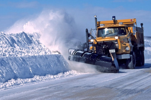 commercial snow plow at work