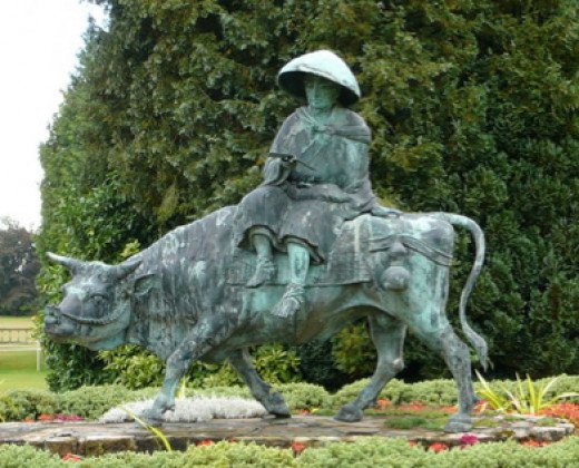 A statue depicting the Taoist sage Lao Tse mounted on a tamed wild ox, an allusion to gaining control over one's mind.  The ox-herding allusion was created by a Zen Buddhist Master in the 12th century.