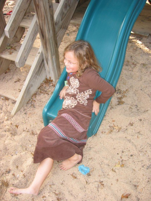 Girl on Slide.  Don't forget to leave party time for outdoor free play too!