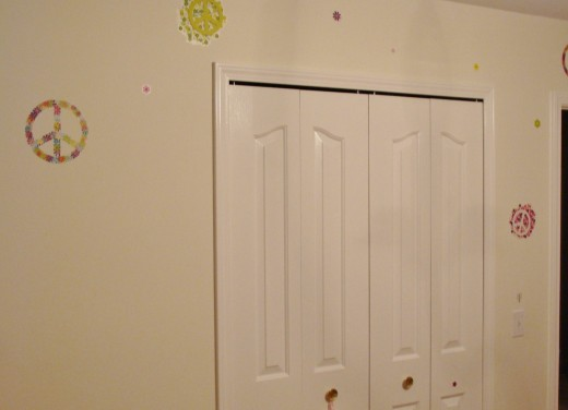 Even a small package of decals can be spread out over several walls and continue the look of the room.