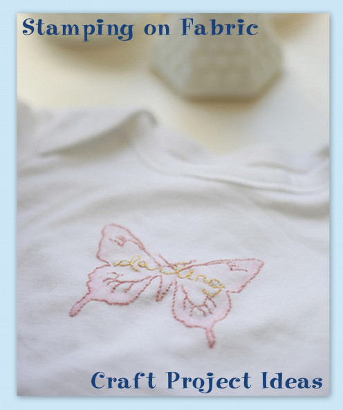 Stamped and stitched butterfly on a onesie.