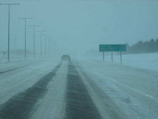 While driving in the snow, it's best to remain in any tire tracks where the road is visible.
