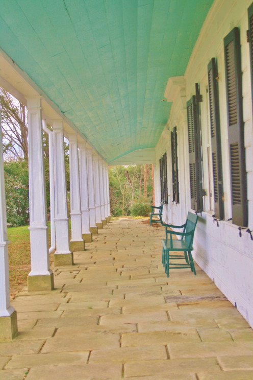 A long, narrow porch fronts Sotterley Mansion, which overlooks the Patuxent River.