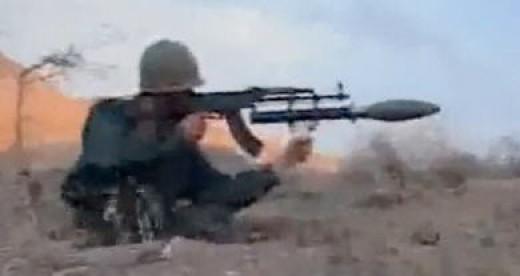 Iranian soldier firing a gas grenade