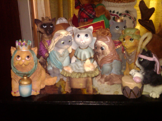 My son's favorite nativity.  He puts it up every year.  The orange kitten in the manger looks like one of our cats, Mordecai.