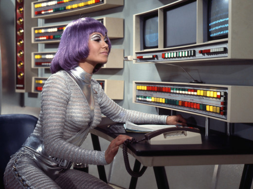 "Female Moonbase personnel wore the infamous ""Purple Wig""."