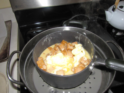 Melt ingredients in top of double boiler until melted and combined.