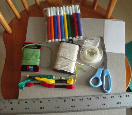 Plain cotton kitchen string works well, is inexpensive, and is easy to handle.