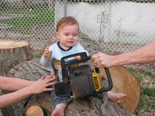 A toddler with a chain saw?