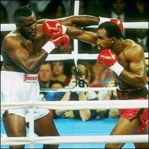 Evander Holyfield knocked out Buster Douglas in 1990 to win the Heavyweight championship of the world.