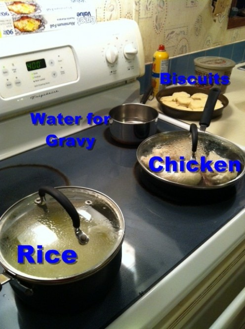Rice and chicken cooking on stove. Water for the gravy and biscuits are waiting their turn. Credit: Chase Snoke