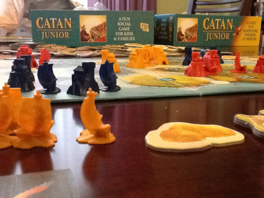 A close-up of the disappointing plastic pieces. Everything else about the game is really high quality.
